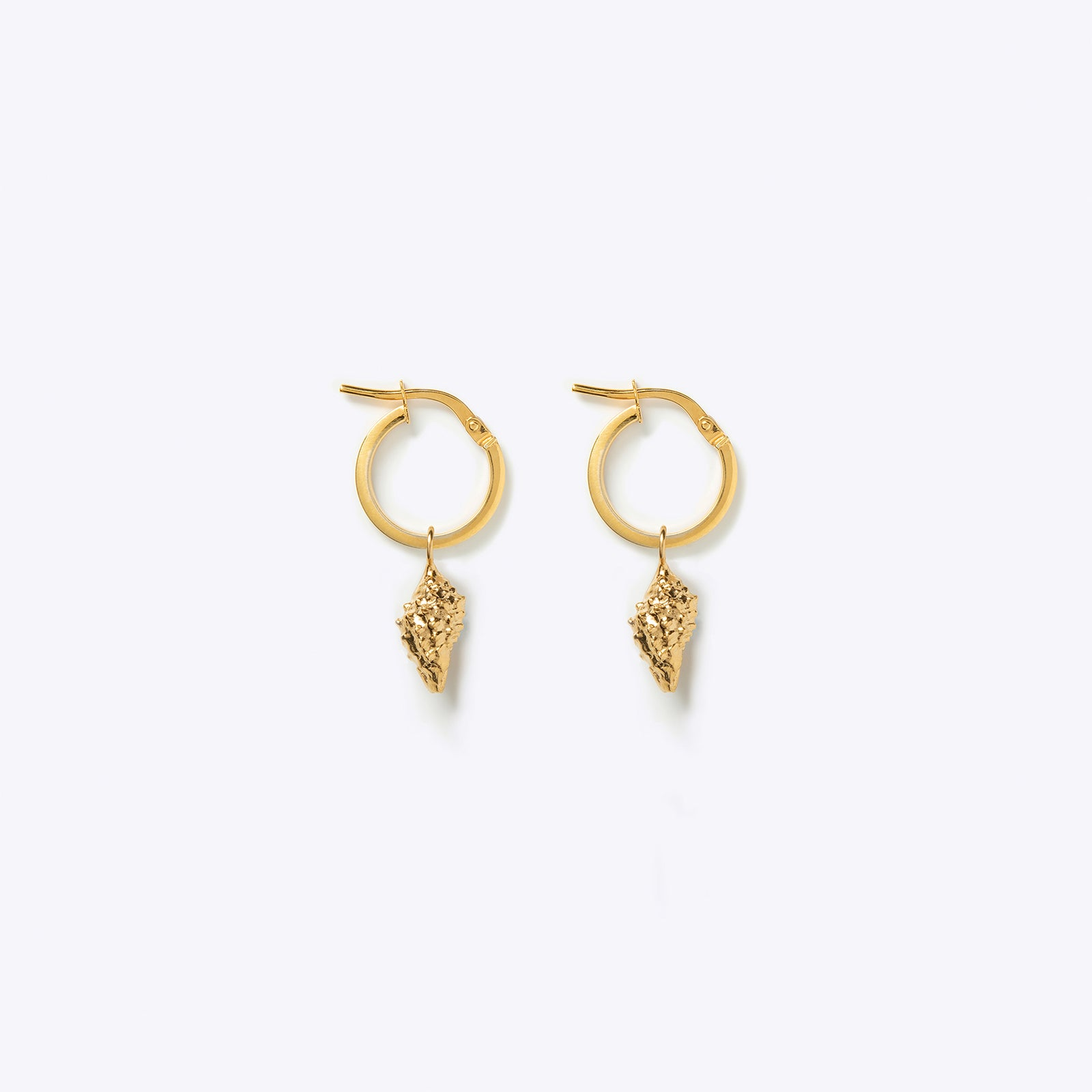 Wanderlust Life creole gold hoop earrings with concha shell charm. Designed in the UK, ethically made in the UK.