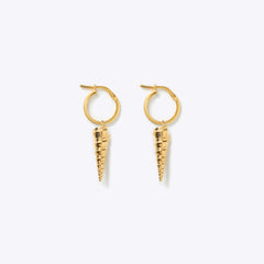 Wanderlust Life creole gold hoop earrings with narhwal shell charm. Designed in the UK, ethically made in the UK.