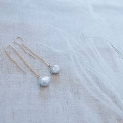Wanderlust Life Ethically Handmade jewellery made in the UK. Minimalist gold and fine cord jewellery. the wedding collection, waterfall earring, grey tumbled pearl