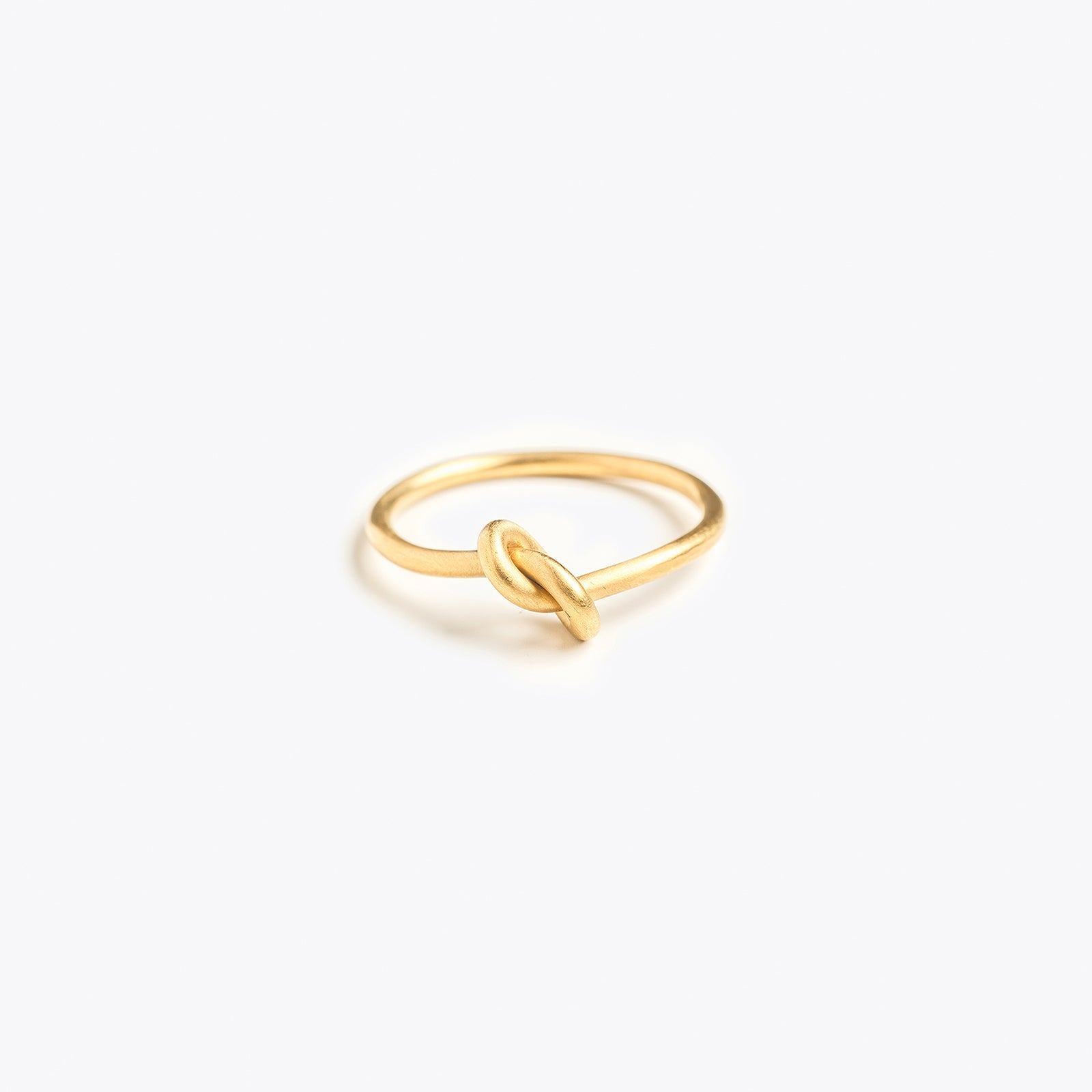 Wanderlust Life gold love knot ring. Ring available in various sizes. Handmade ring in the UK.