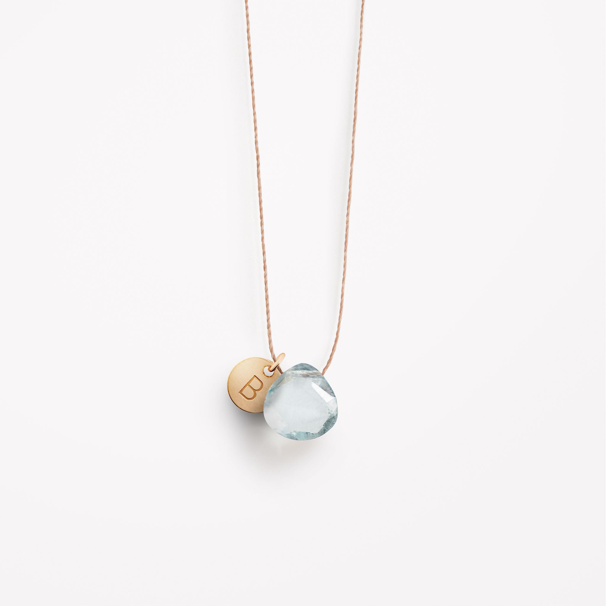 Wanderlust Life Ethically Handmade jewellery made in the UK. Minimalist gold and fine cord jewellery. Personalised aquamarine gemstone fine cord necklace with gold personalised tag.