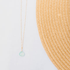 Wanderlust Life gold chain necklace with sea glass chalcedony gemstone. Sea Glass gemstone necklace with adjustable 17
