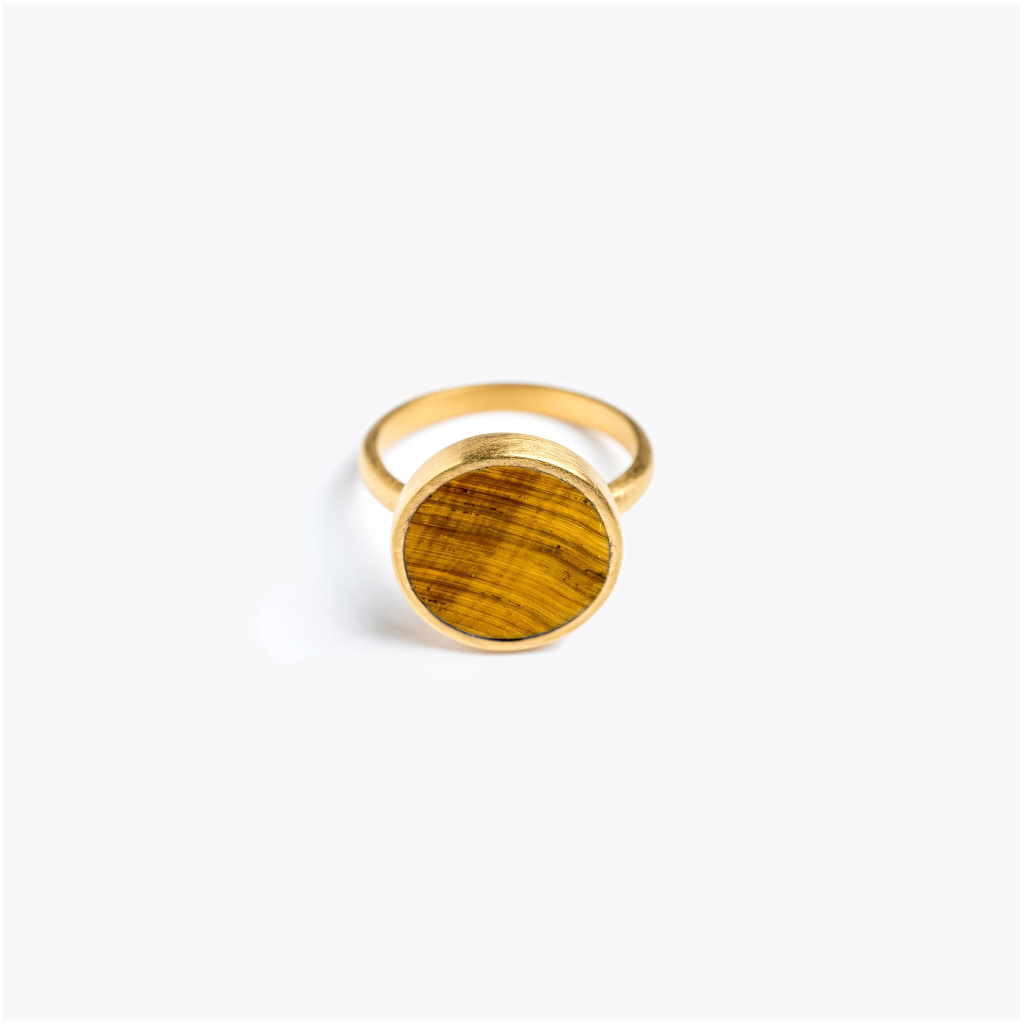 Wanderlust Life semi precious tiger eye gemstone gold ring. Gold band ring with large tigers eye gemstone slice. Wanderlust Life jewellery, designed in the UK.