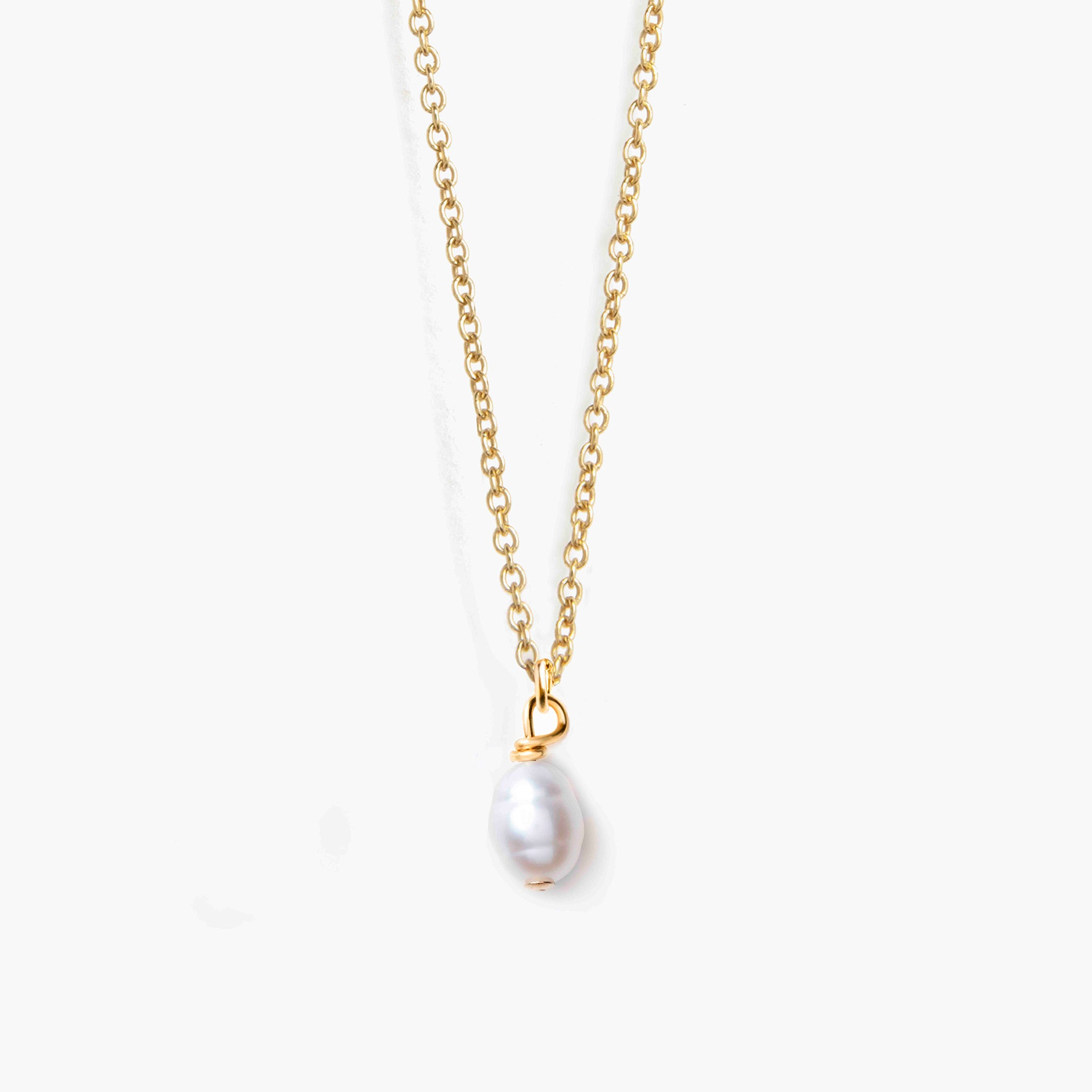 14k Gold fill chain necklace with white pearl amulet. Hand made sentimental jewellery by Wanderlust Life, in the UK.