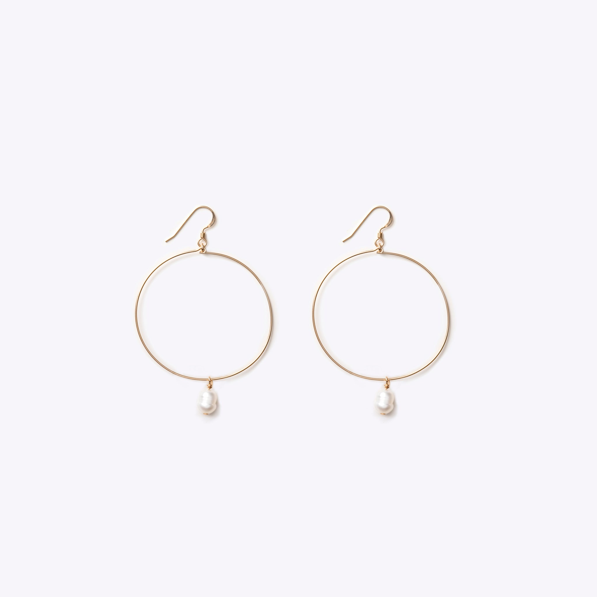 Wanderlust Life pearl jewellery collection. Large gold pearl hoop earrings, Wedding jewellery handmade in the UK.