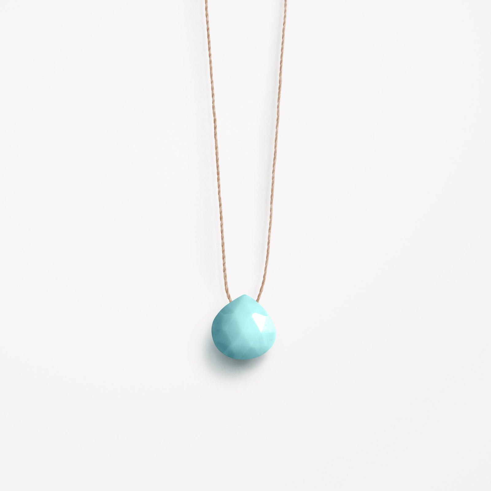 Wanderlust Life Ethically Handmade jewellery made in the UK. Minimalist gold and fine cord jewellery. december birthstone, arizona turquoise fine cord necklace