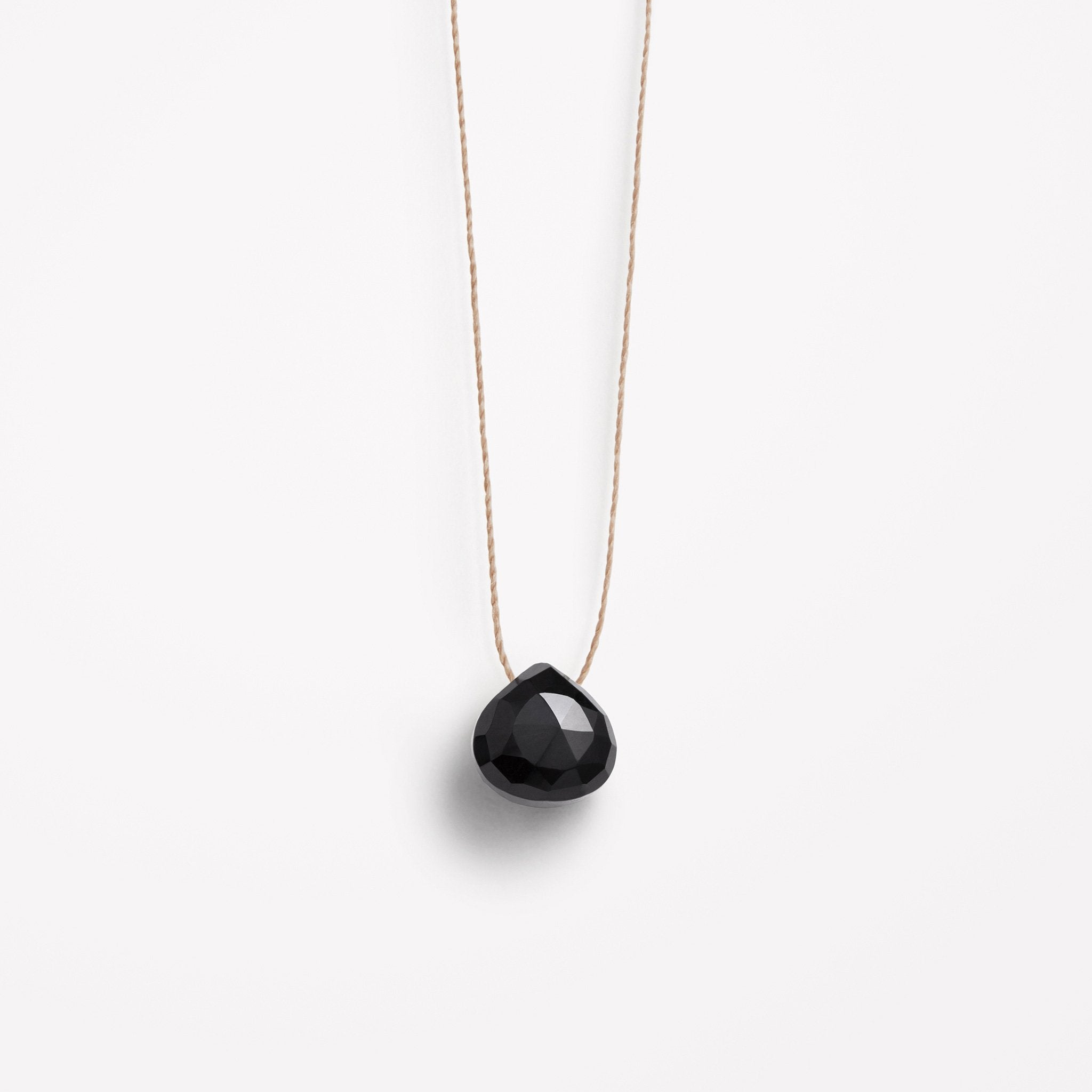 Wanderlust Life Ethically Handmade jewellery made in the UK. Minimalist gold and fine cord jewellery. black spinel fine cord necklace