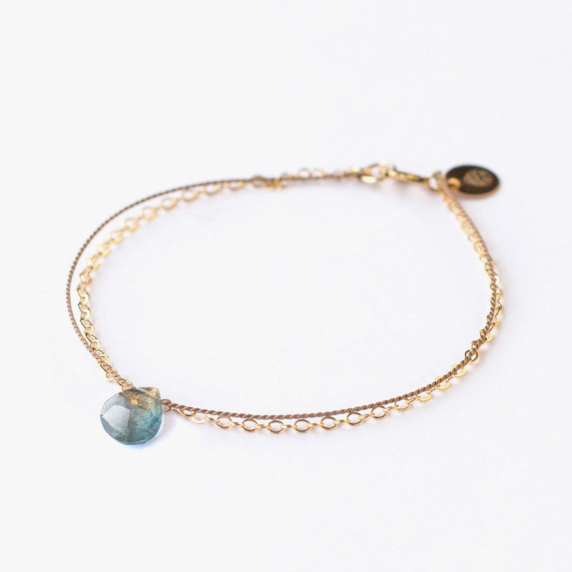 A delicate 14k gold filled Wanderlust Life chain and silk cord aquamarine semi precious gemstone bracelet