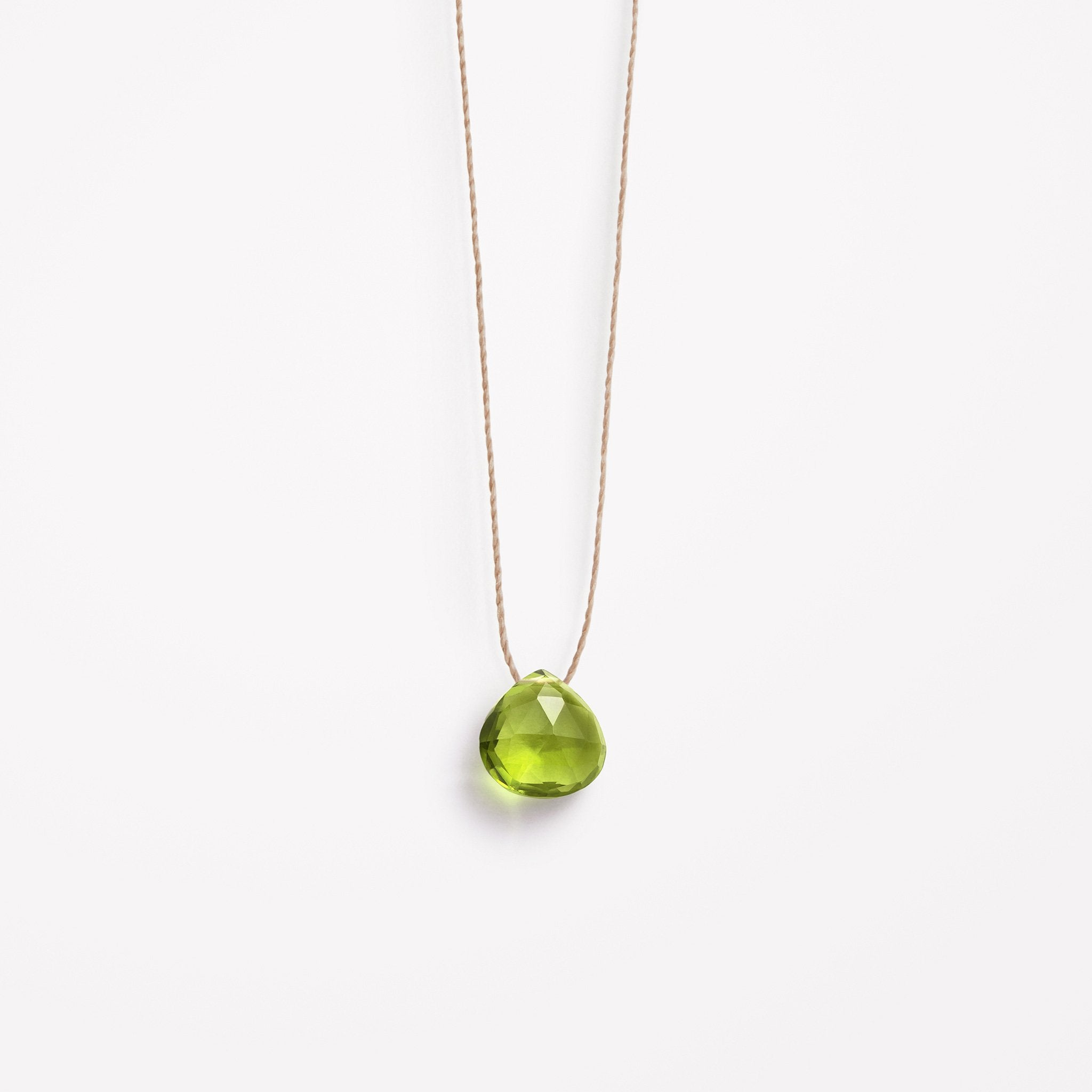 Wanderlust Life Ethically Handmade jewellery made in the UK. Minimalist gold and fine cord jewellery. august birthstone, green peridot fine cord necklace