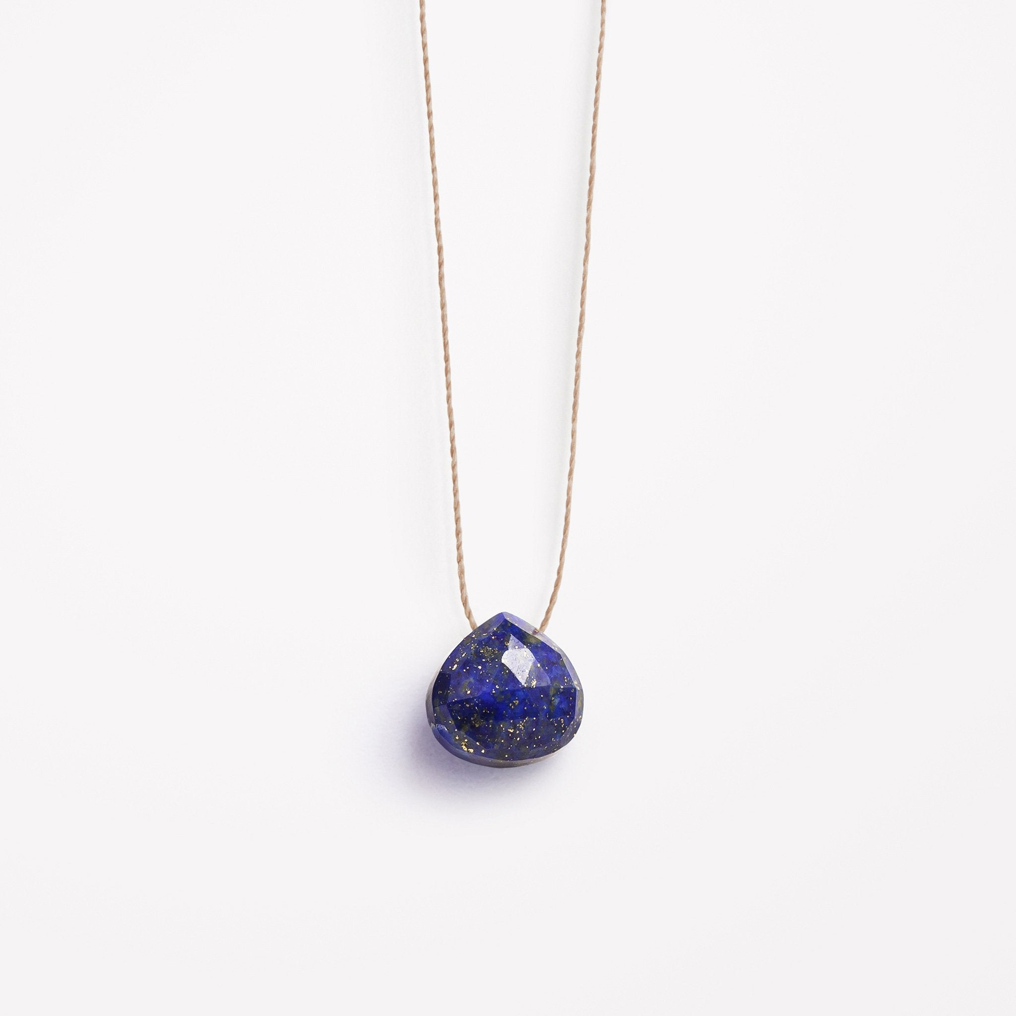 Wanderlust Life Ethically Handmade jewellery made in the UK. Minimalist gold and fine cord jewellery. third eye, lapis lazuli fine cord necklace