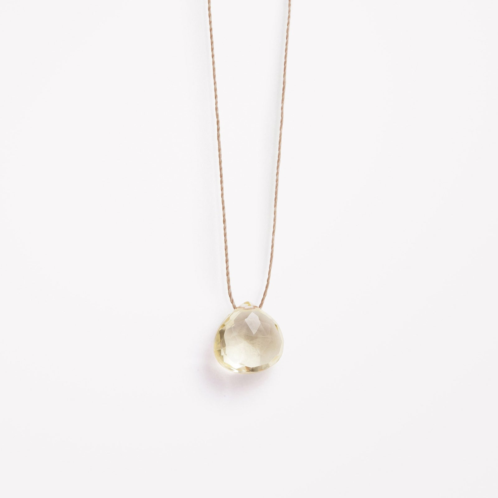 Wanderlust Life Ethically Handmade jewellery made in the UK. Minimalist gold and fine cord jewellery. solar plexus, lemon quartz fine cord necklace