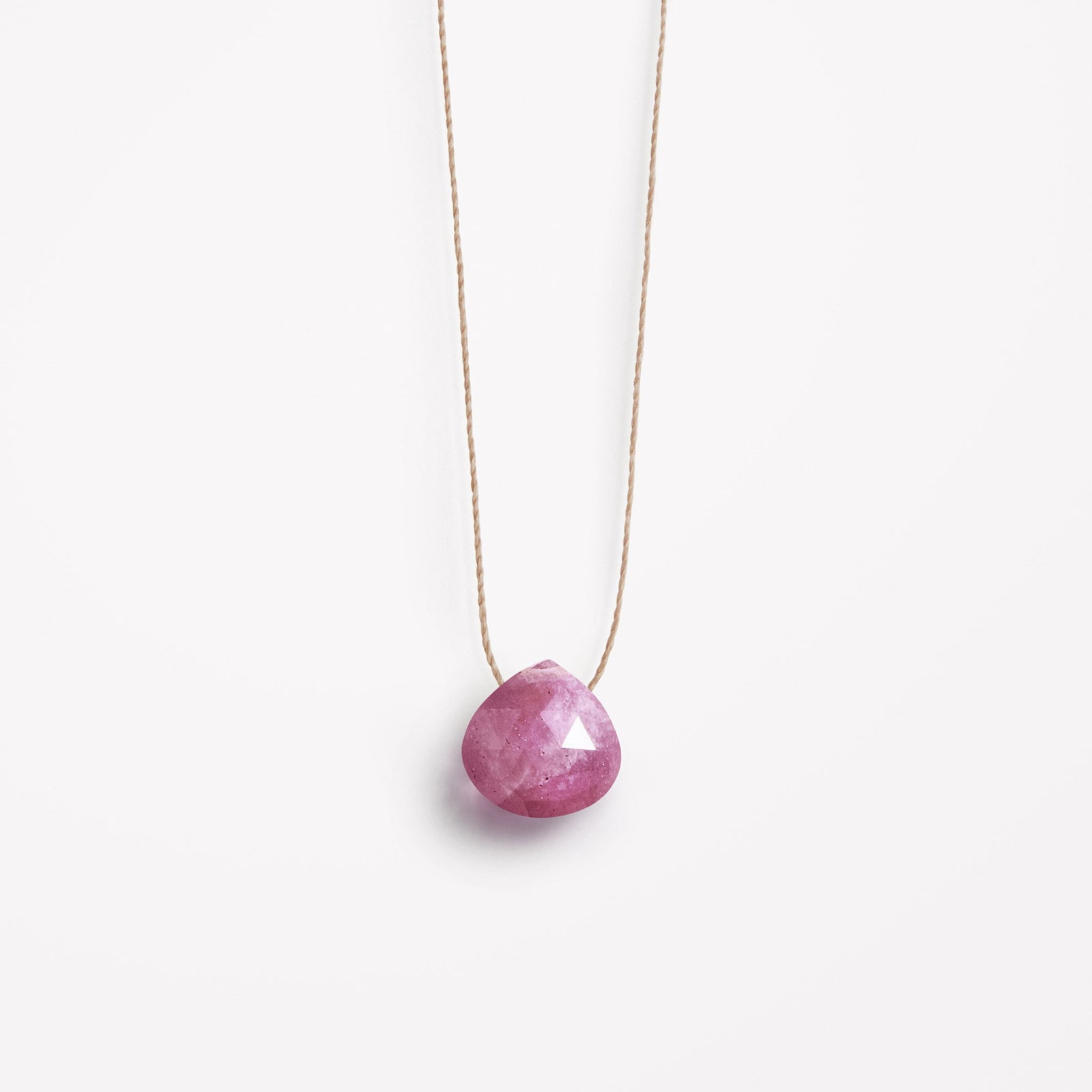 Wanderlust Life Ethically Handmade jewellery made in the UK. Minimalist gold and fine cord jewellery. september birthstone, pink sapphire fine cord necklace