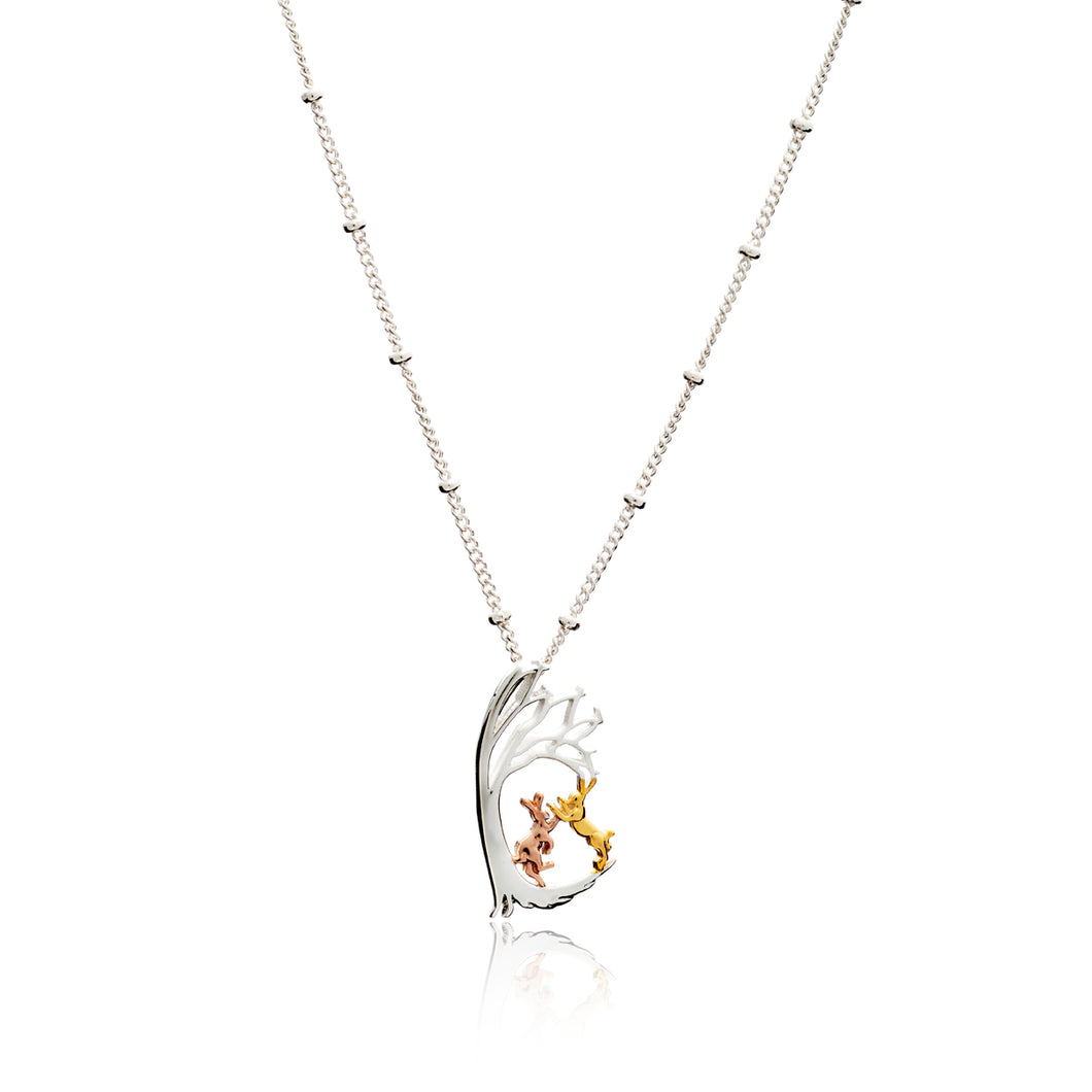 Boxing Hares Under a Tree Pendant