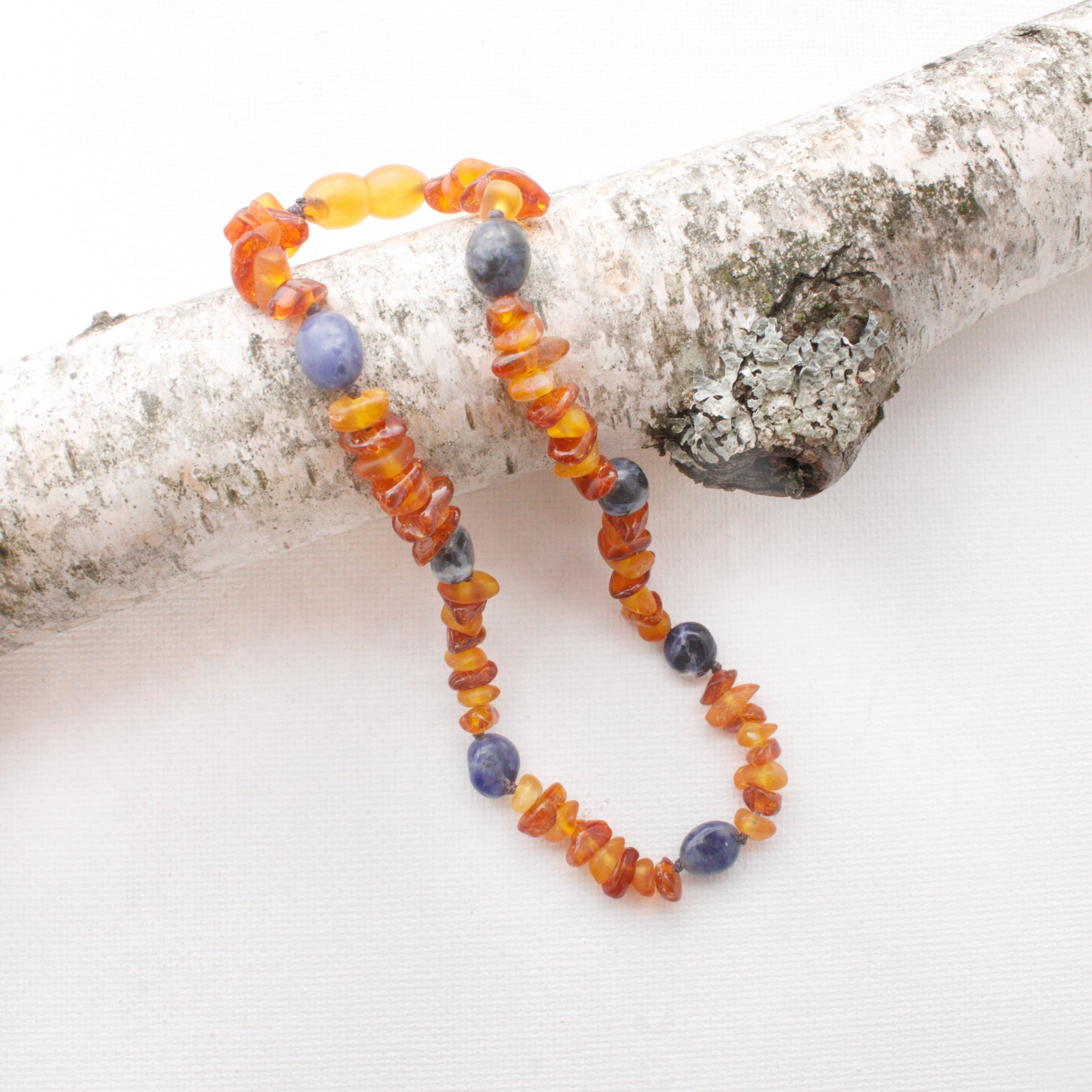 Baltic Amber Teething Necklace | Raw Honey + Cognac Amber + Sodalite