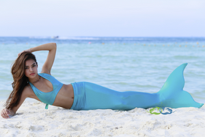 Miami teal mermaid on beach