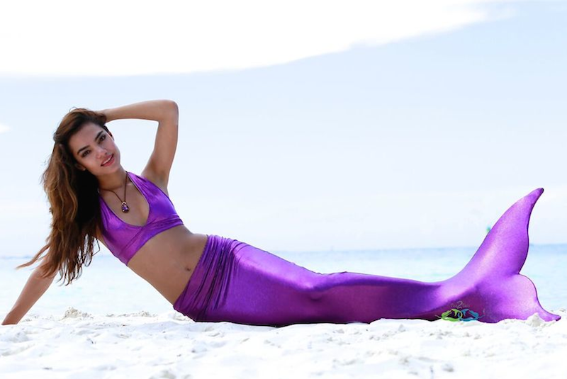 Sparkle purple mermaid on the beach