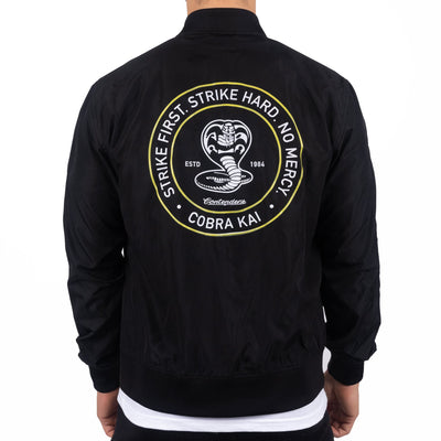 Contenders Clothing cobra kai circle stamp bomber contenders black TheDrop