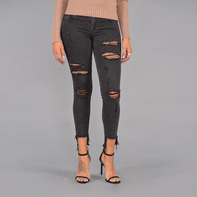 Seize Desist Los Angeles mid rise distressed step hem w raw cut jeans seize desist black TheDrop