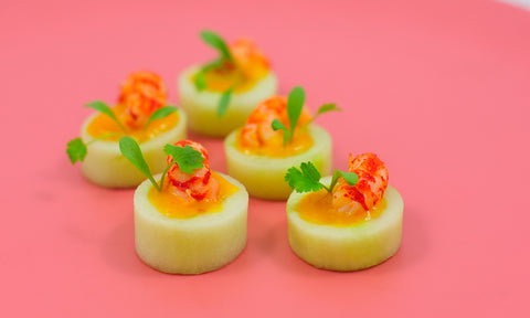 Crayfish tail, mango gel & red chilli in cucumber cup