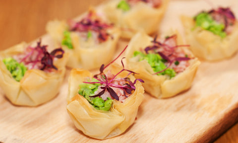 Ham hock, crushed peas & chives on filo cup