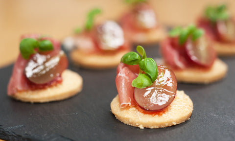 Parma ham, blossom honey & red grape on Parmesan shortbread