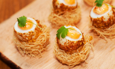 Dukkah crusted quail egg w/ harissa mayo on kadaifi pastry nest
