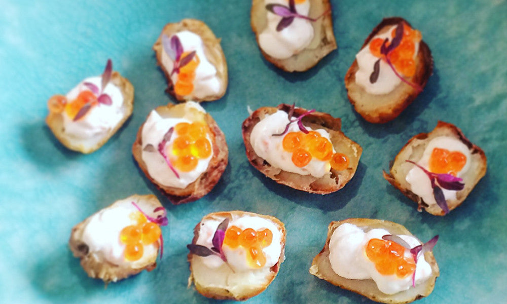 Smoked salmon mousse in baby potato w/ lumpfish caviar