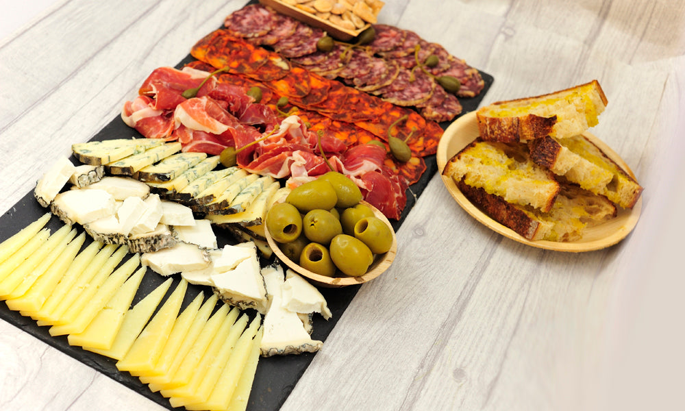 Spanish cheese & charcuterie platter w/ marcona almonds, gordel olives & bread