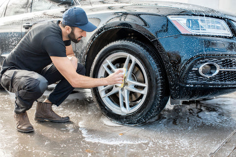 man utilizing best tire shine and cleaning methods