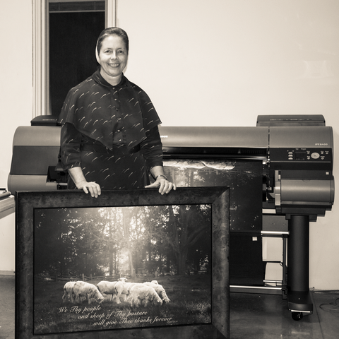 Glenna Bayer in front of Canon large-format printer