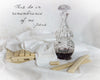 Unleavened communion bread and wine in crystal decanter