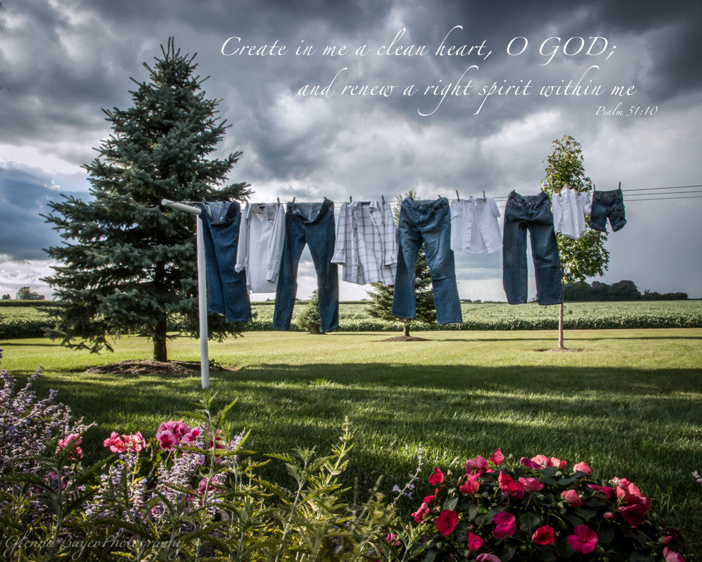 Jeans and shirts on clothesline with spring flowers and scripture verse