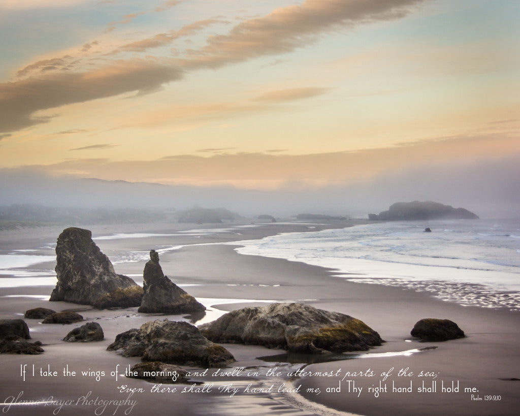 A blue, yellow sunrise at Bandon Beach in Oregon with scripture verse.