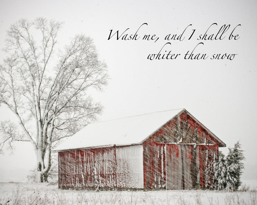 Old red barn in a snow storm with scripture verse