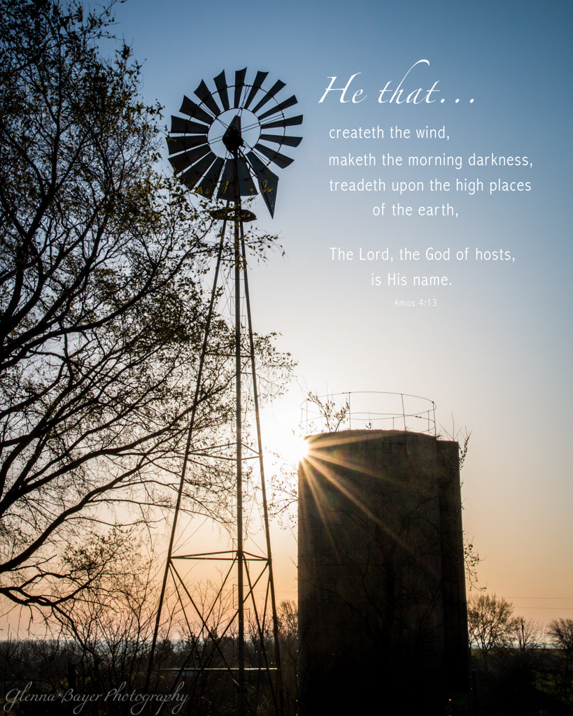 Silhouette of silo and windmill at sunrise in Kansas with scripture verse