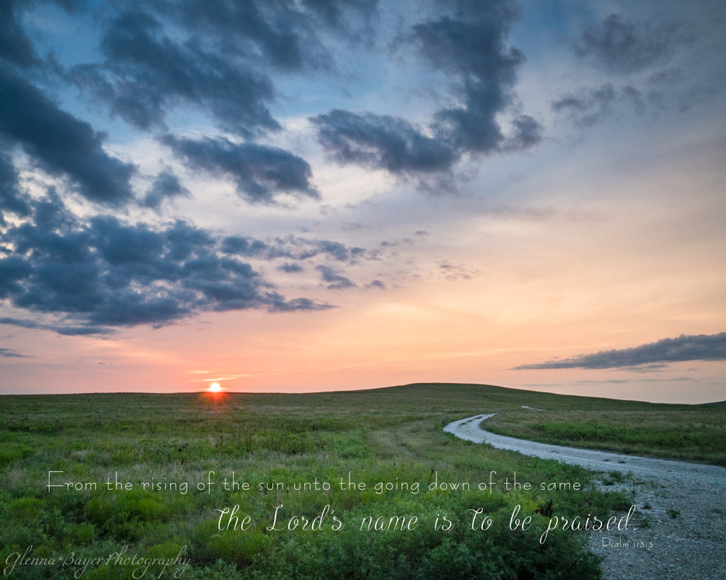 Gravel road through the grassy landscape of the Flint Hills in Kansas during sunset with scripture verse