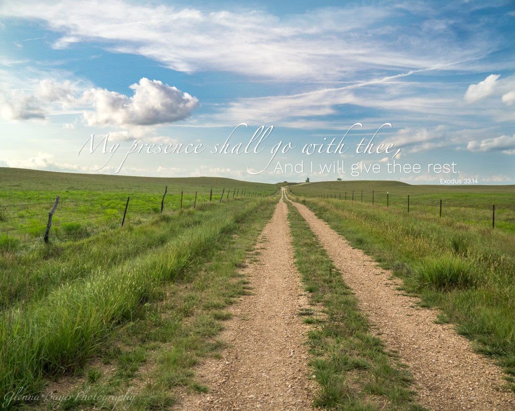 Gravel road through grassy landscape in Kansas with scripture verse