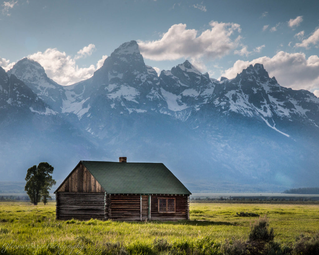 Log cabin and mountains in the Teton National Park
