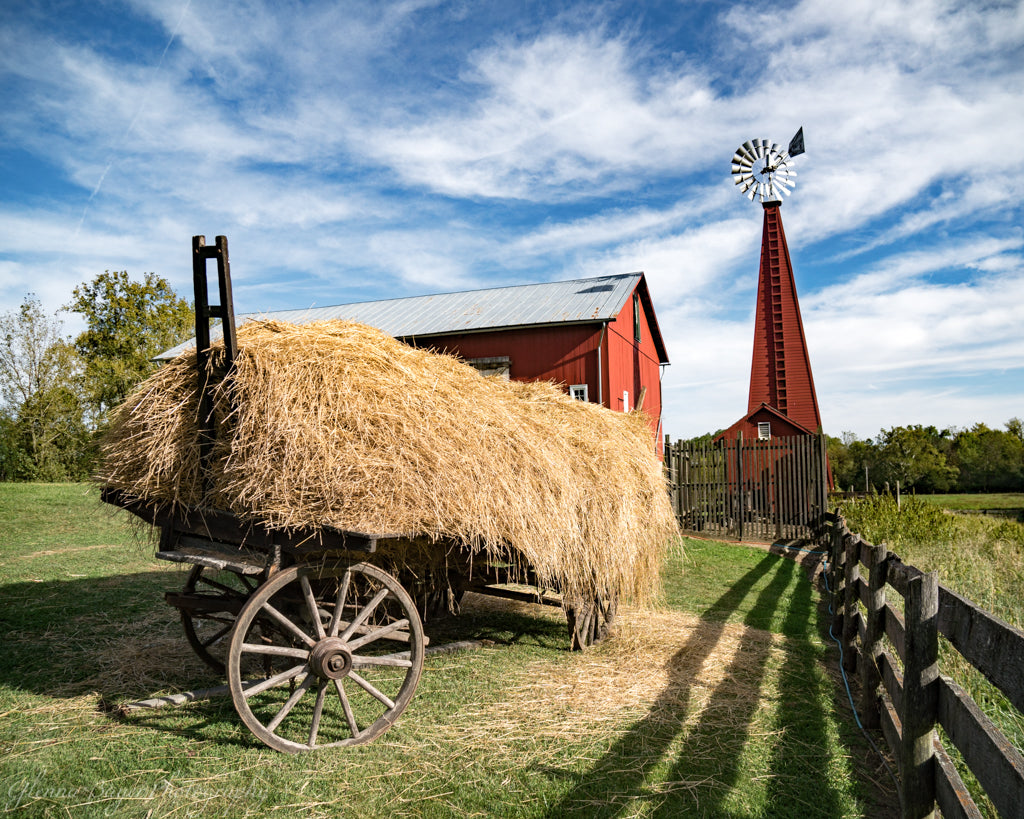 Straw wagon, red barn, and windmill