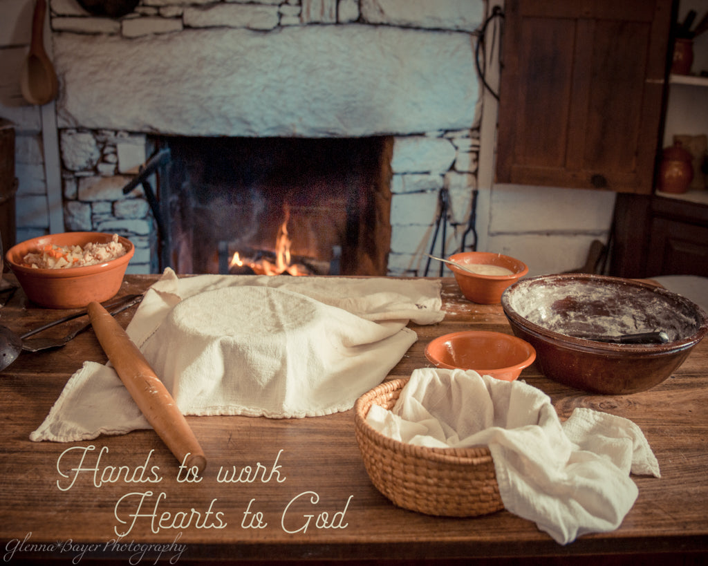 "Old time baking with fireplace with quote ""Hands to work, Hearts to God"""