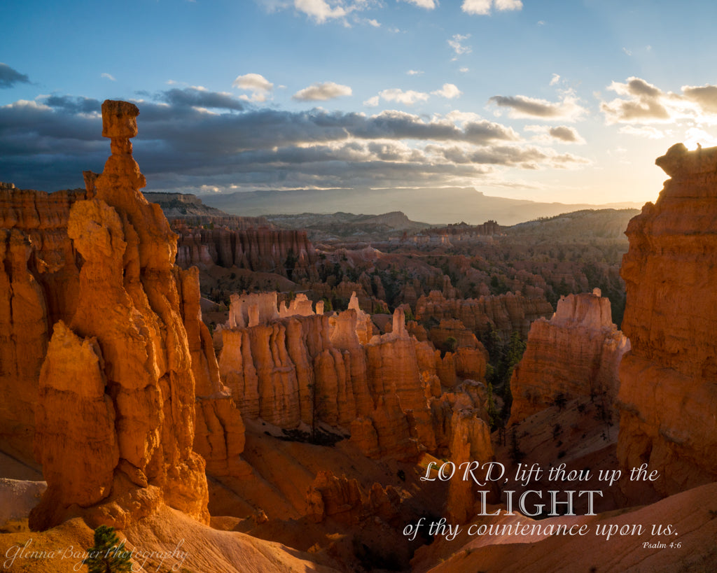 Hoodoos and arch at sunrise in Bryce Canyon National Park with bible verse.