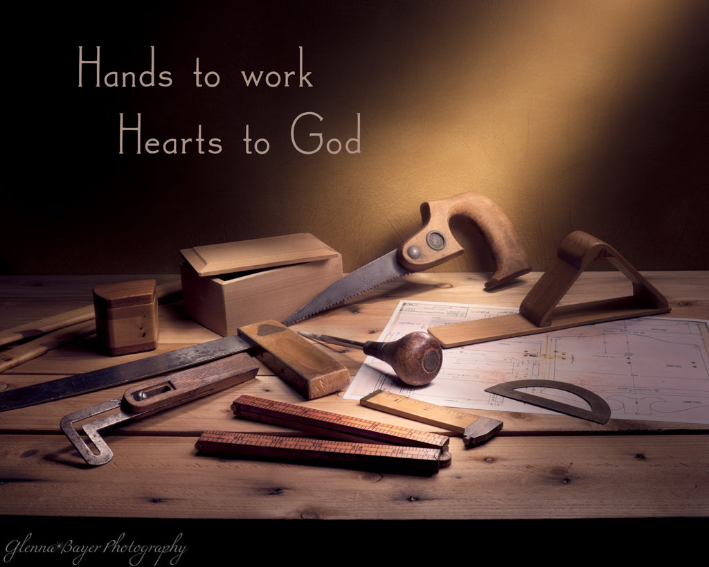 "Old woodworking tools still life with quote ""Hands to work, Hearts to God"""