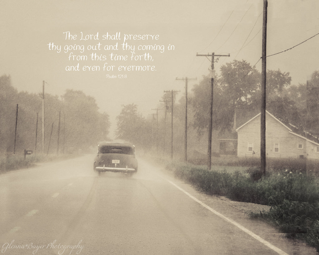 Old vintage car driving through rain on Route 41 with scripture verse