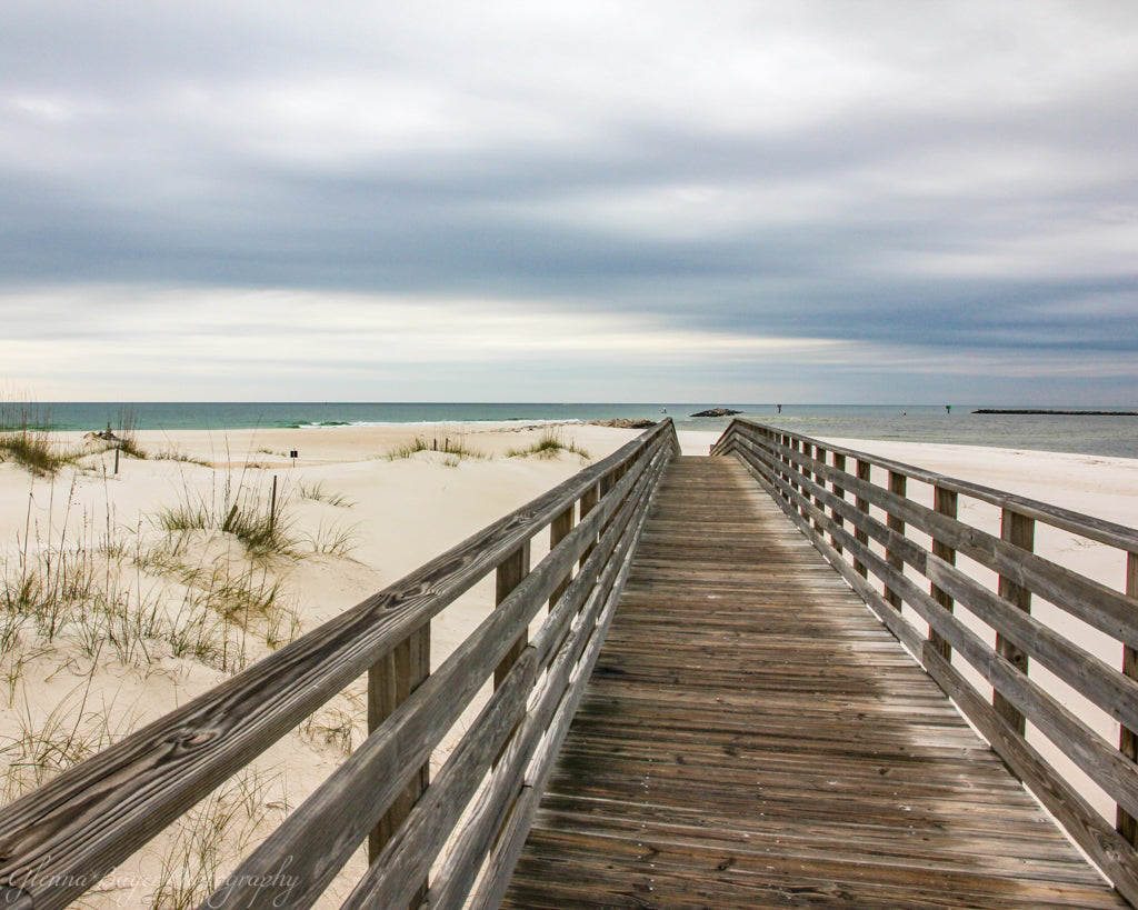 Wooden boardwalk on beach in Pensacola, Florida
