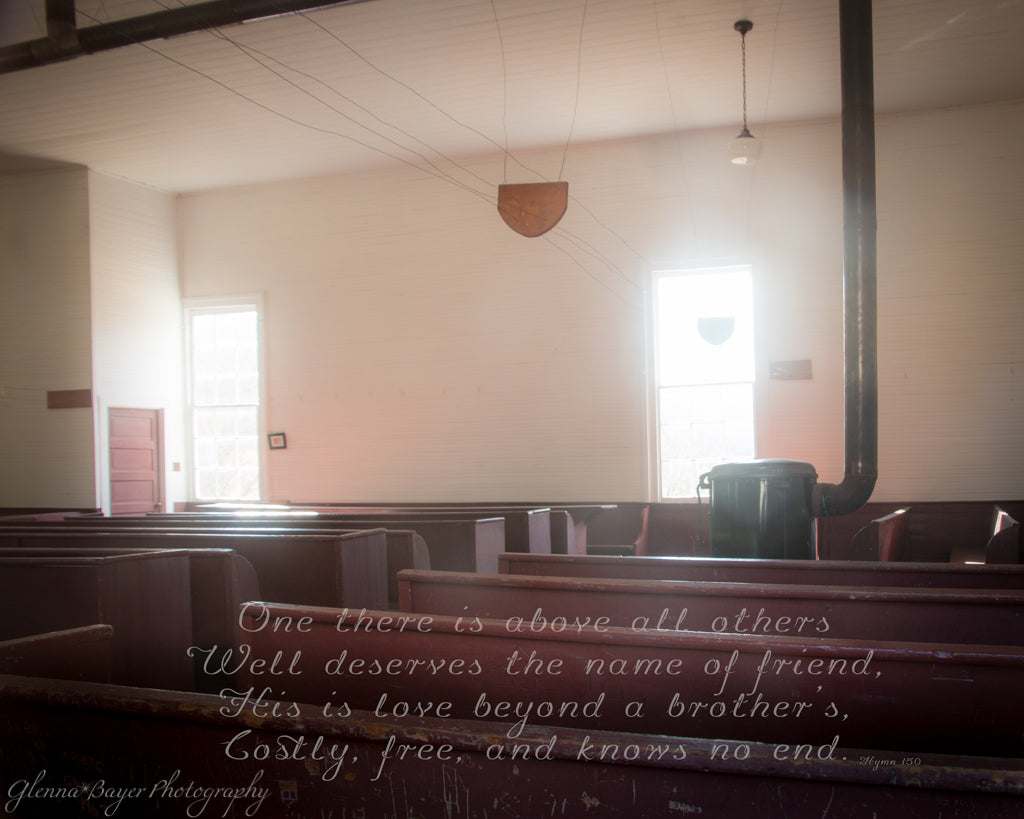 Old German Baptist Brethren Church with wooden benches and stove with song verse