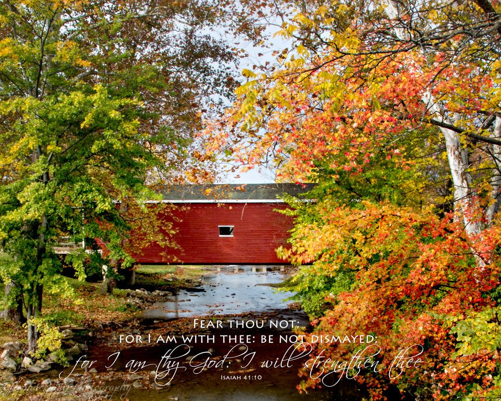 Red covered bridge with Autumn tree in Eaton, Ohio with scripture verse