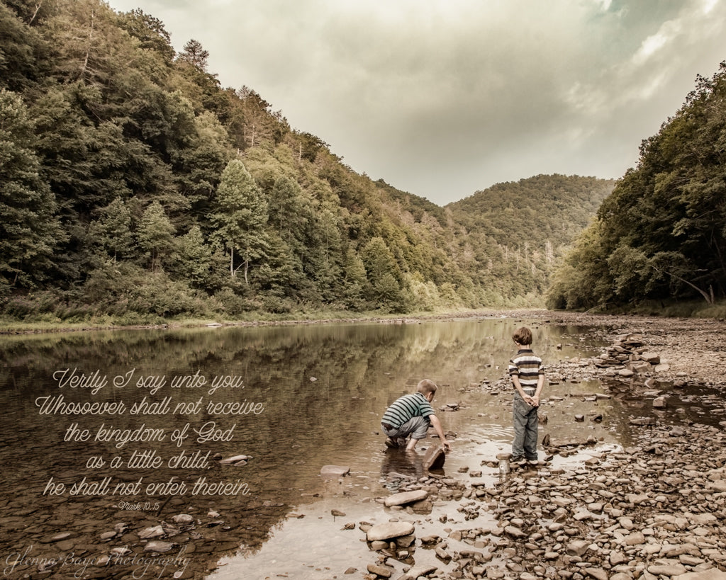 Two boys catching crawfish in a river with scripture verse