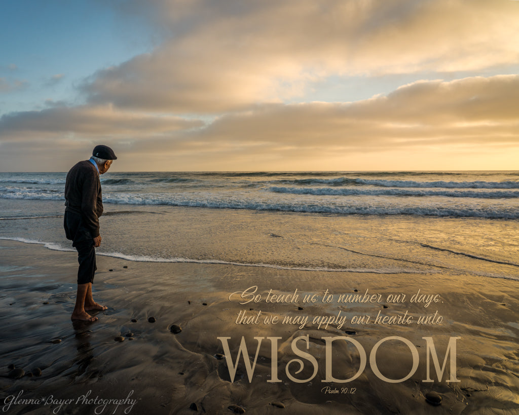 Old man standing next to the sea watching the sunset in San Diego with scripture verse