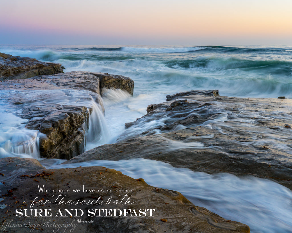 Blue waves rushing over rocks in San Diego, California with scripture verse