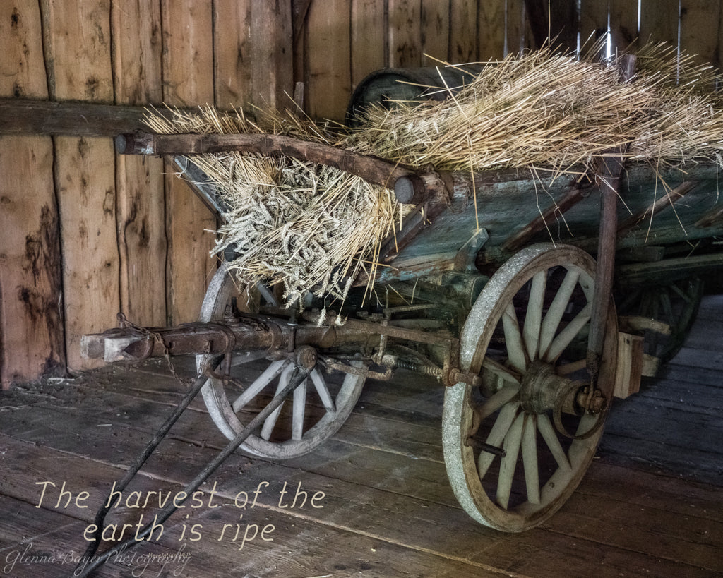 Old harvest wagon in Bavaria, Germany with Scripture verse